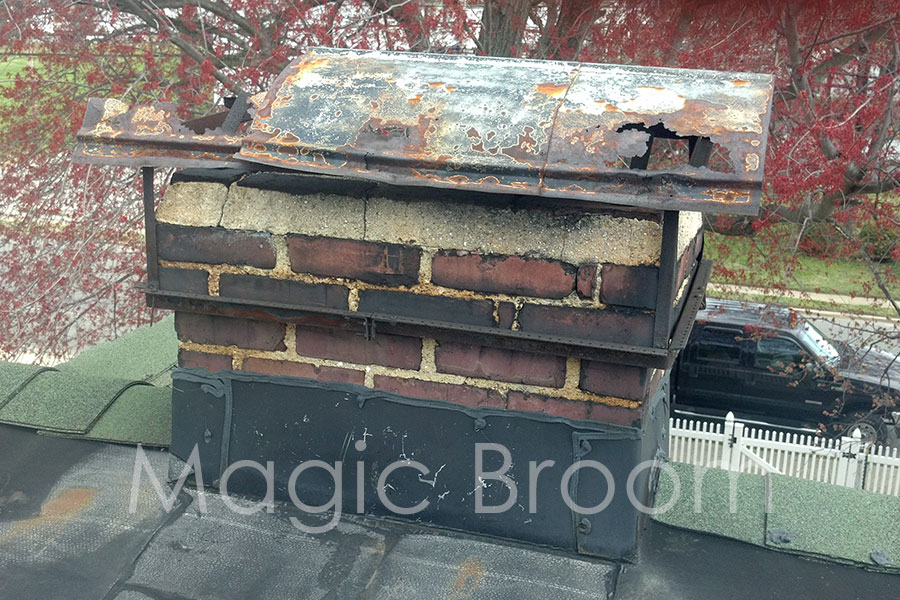 rusted chimney cap and deteriorated chimney crown