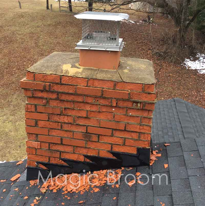 spalling chimney with broken brick pieces