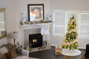 a fireplace with a holiday tree